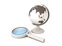 School world globe and a magnifying glass Stock Images