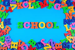 School written by plastic colorful letters on a blue Stock Photography