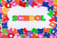 School written by plastic colorful letters on a white Royalty Free Stock Photo