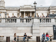 School youth and adults lounging outside National Gallery in Tra Stock Photos