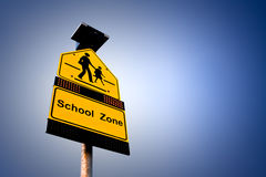 School Zone. A school area sign used for acknowledge diver to be careful Royalty Free Stock Images