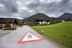 School zone road sign painted on the road Royalty Free Stock Image