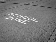 School Zone. Roadway marking indicating this part of the road is near a school zone Royalty Free Stock Photo