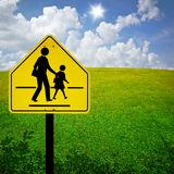 School Zone Sign With Field. And sky Background royalty free stock photo