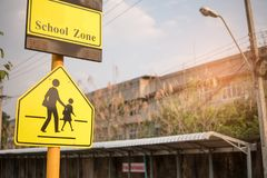 School zone sign. Road sign caution sign - school crossing stock photography