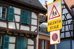School zone signage. Slow down school zone crossing road signage in french Royalty Free Stock Photography