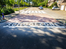 School zone. In white letters painted on street near school royalty free stock image