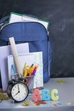 Schoolbag near the teacher's board Stock Image