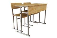 Schoolbank en stoelenvoorzijde op witte achtergrond wordt geïsoleerd die 3d aangaande Royalty-vrije Stock Afbeeldingen