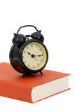 Schoolbook with clock Stock Images