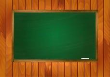 Schoolbord op houten achtergrond Stock Afbeelding