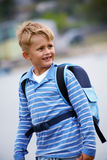 Schoolboy. Portrait of happy schoolboy with satchel on his back Stock Photo