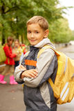 Schoolboy. Portrait of happy lad with rucksack on back looking at camera Stock Photos