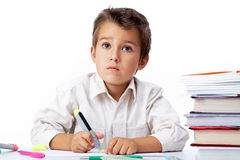 Schoolboy. Portrait of a little schoolboy drawing Royalty Free Stock Image
