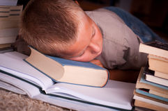 Schoolboy. Image of young boy sleeping near books Royalty Free Stock Images