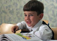 Schoolboy. Portrait of a smiling schoolboy with the textbook Stock Photography