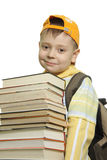 Schoolboy. With pile of books isolated over white Royalty Free Stock Image