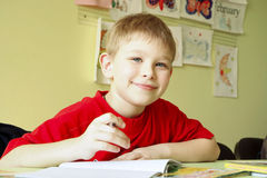 Schoolboy. Young schoolboy writing test in classroom stock photo