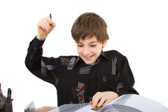 Schoolboy. Child with study of the difficulties on white background Royalty Free Stock Photography