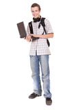 Schoolboy. Casual teenager with laptop. over white background Royalty Free Stock Photos