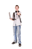 Schoolboy. Casual teenager with laptop. over white background Stock Photos
