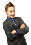 Schoolboy. In a gray coat with a blue tie Royalty Free Stock Photography