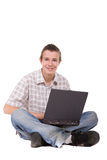 Schoolboy. Casual teenager with laptop. over white background Stock Photo