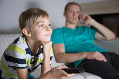 Schoolboy addicted to watching tv Stock Photography