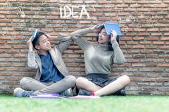 Free Schoolboy And Schoolgirl Siting Book And Hand Drawn Stock Image - 109200001