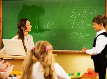 Schoolboy answering near blackboard Stock Photography