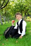 Schoolboy with apple outdoors Royalty Free Stock Images