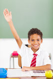 Schoolboy arm up. Cute elementary schoolboy arm up in classroom royalty free stock images