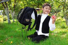 Schoolboy with backpack and apple Royalty Free Stock Images