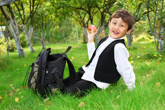 Schoolboy with backpack and apple Royalty Free Stock Photography