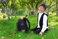 Schoolboy with backpack and apple Stock Image