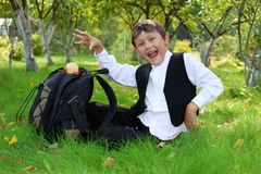 Schoolboy with backpack and apple Stock Photo