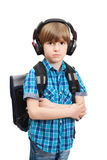 The schoolboy with backpack in bad mood Stock Photo