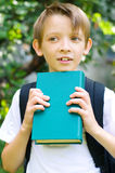 Schoolboy with backpack and book Royalty Free Stock Image