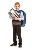 Schoolboy with backpack holding books. Little smiling child boy with school backpack holding education books in hands Stock Photography