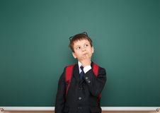 Schoolboy with backpack on school board background Royalty Free Stock Photography