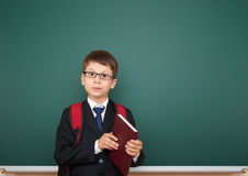 Schoolboy with backpack on school board background Royalty Free Stock Images