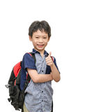 Schoolboy with backpack smiles and show thumb up Royalty Free Stock Image