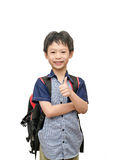Schoolboy with backpack smiles and show thumb up Royalty Free Stock Photo