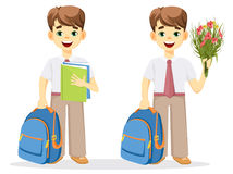 Schoolboy with backpack, textbook and bouquet of flowers. Stock Photography