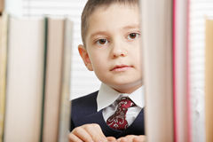 Schoolboy behind books Stock Image