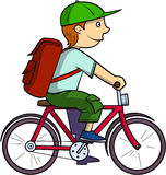 Schoolboy on a bike. Schoolboy with red bag and green hat ride a red bike Stock Photos