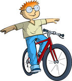 Schoolboy on bike. Rides with no hands Royalty Free Stock Photos