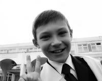 A schoolboy in a black tie Royalty Free Stock Image