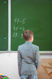 Schoolboy at the blackboard Stock Image