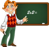 Schoolboy by blackboard. Royalty Free Stock Images